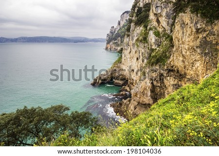 Coast of the Buciero Mountain in Santona, Cantabria, Spain - stock photo