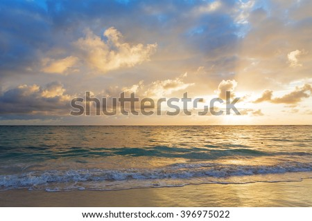 Coast of the tropical island. Morning sun. Beautiful place for restoration of forces, rest, aquatics, suntan and bathing. Warm sea water, white sand, breeze.