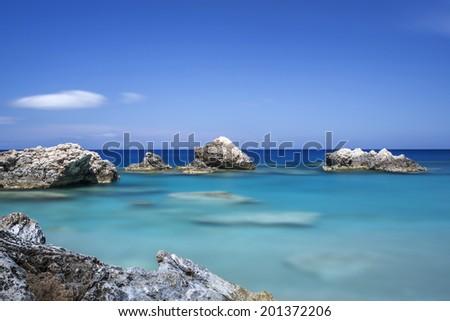 Coast on Karpathos island, Greece. Shot taken with longtime exposure. - stock photo