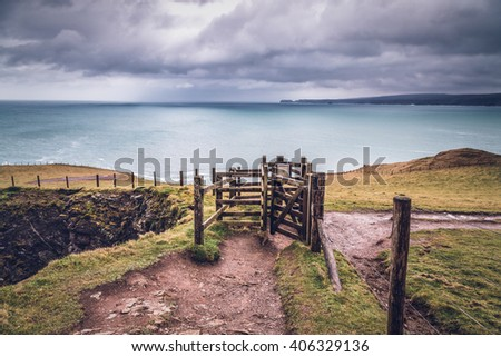 coast path near port isaac cornwall england uk with old gate.