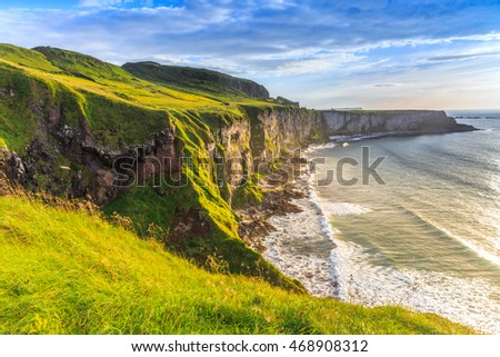 Coast with green grass nearby a carrack-rede-rope, Northern Ireland, UK.