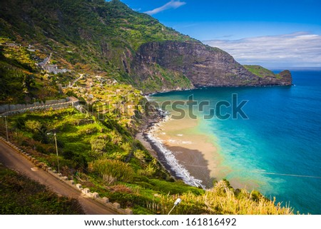 coast with small village on madeira island in sunny day at the winter, portugal - stock photo