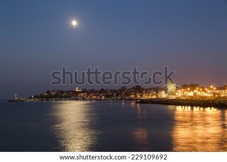Coastal city at night - stock photo