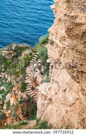 Coastal cliff with old stone stairway. Bulgaria, Black Sea Coast, Kaliakra headland - stock photo