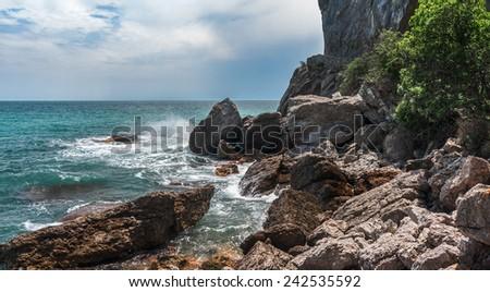 Coastal cliffs, coastline, rocky shore, the view from the sea side, Crimea peninsula, Ukraine, Black Sea Coast  - stock photo