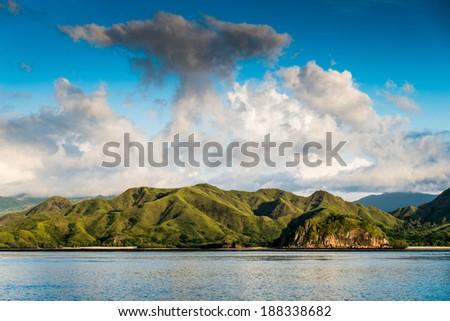 Coastal landscape of island Komodo National Park, UNESCO World Heritage Site, Indonesia, Southeast Asia - stock photo