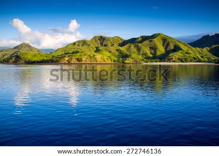 Coastal landscape of island Komodo National Park, UNESCO World Heritage Site, Indonesia, Southeast Asia - stock photo