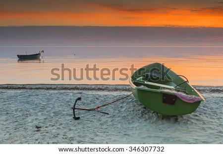 Coastal landscape with anchored fishing boats at dawn, Baltic Sea - stock photo