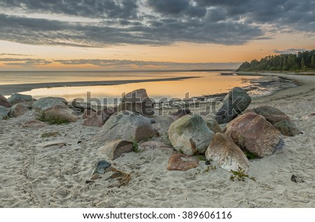 Coastal landscape with remains of old broken berth, Baltic Sea - stock photo