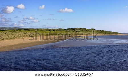 coastal walk and running area by sandy beach - stock photo