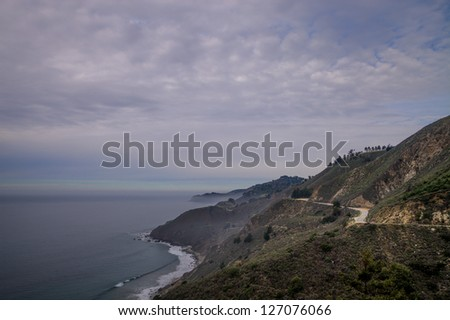 Coastal weather road and sky - stock photo