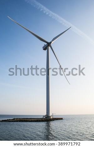 Coastal wind turbines in Denmark - stock photo