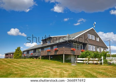Coastal wooden houses in Norway - stock photo