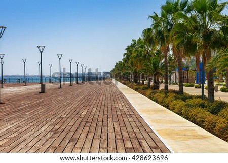 Coastline and promenade in Limassol, island Cyprus, Europe, Mediterranean Sea. Bright sunny day and blue water and sky. - stock photo