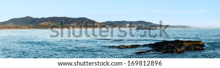 Coastline of Coffs Harbour in New South Wales Australia taken from causeway towards Muttonbird Island Nature Reserve - stock photo