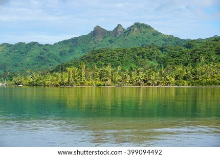 Coastline of Huahine island with lush vegetation, Maroe bay, Pacific ocean, French Polynesia - stock photo