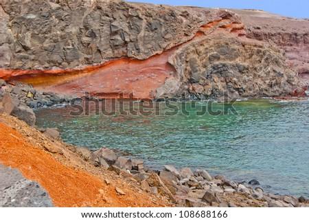 Coastline of Lanzarote with red rocks by Atlantic - stock photo