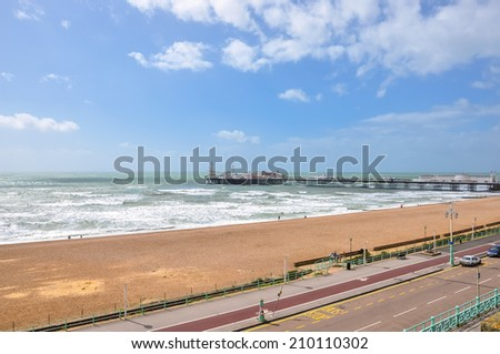 Coastline, pier and beach in Brighton, East Sussex, United Kingdom - stock photo