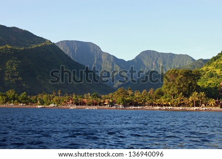Coastline with fish boats and mountains, Bali, Amed  - stock photo