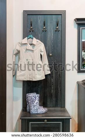 Coat and wellington boot - stock photo