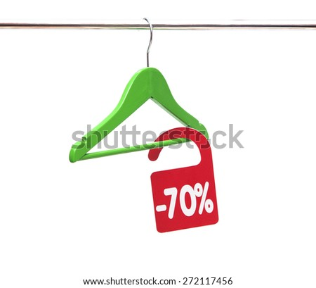 Coat hanger with discount tag - stock photo