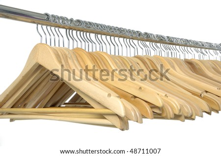 coat hangers on a clothes rail - stock photo