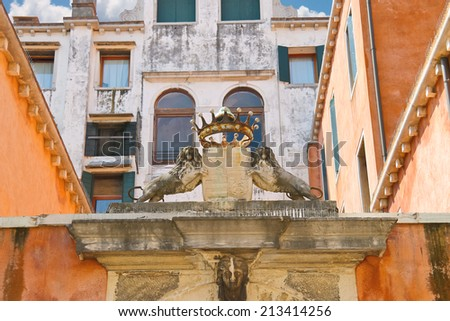 Coat of arms and crown on a building in Venice, Italy - stock photo