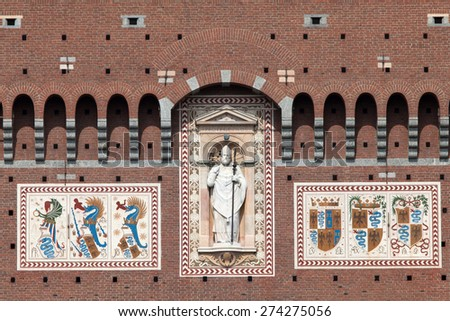 Coat of arms of the Visconti family on the wall of the Filarete Tower of the Castello Sforzesco in Milan, Italy - stock photo
