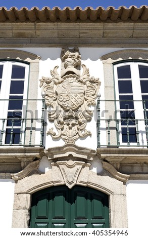 Coat of arms on top of the entrance of the Manor of the Vasconcelos, in Vila do Conde, Portugal - stock photo