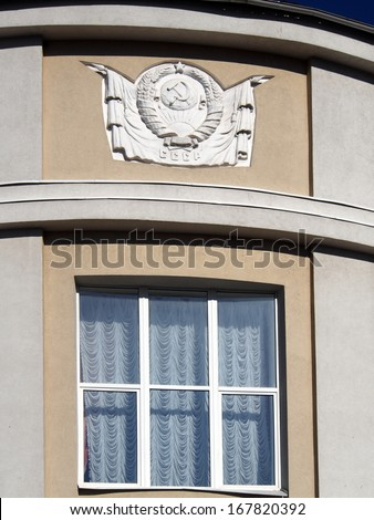 Coat of arms the Soviet Union on the bulding - stock photo