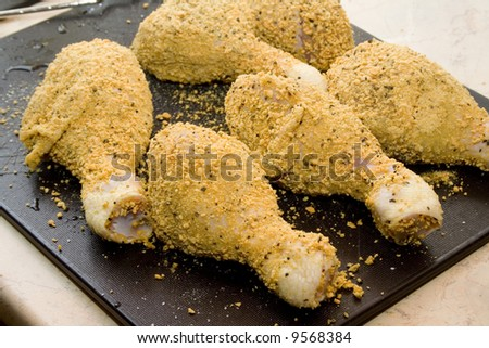 coated raw chicken drumsticks - stock photo