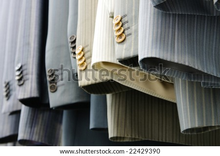 coats in row - stock photo