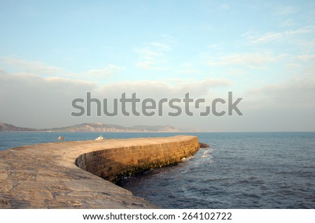 Cobb harbour wall in Lyme Regis, Dorset - stock photo