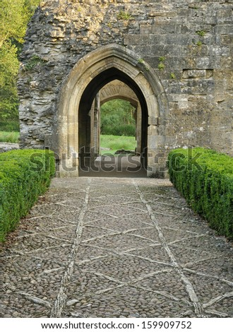 Cobbled path & doorway to Minster Lovell Hall, Oxfordshire - stock photo