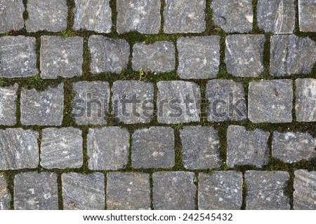 Cobbled pavement made of granite cubes. Background texture.  - stock photo