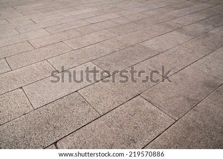 Cobbled stone pavement. - stock photo