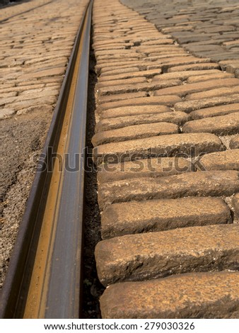 cobbled street and tram track rail, at the National Tramway Museum,Crich,Derbyshire,UK. taken 11/05/2015