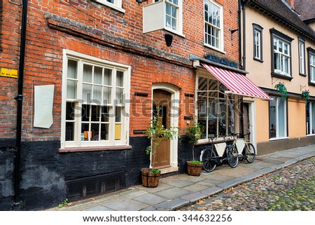 Cobbled streets and shops at Norwich in Norfolk - stock photo