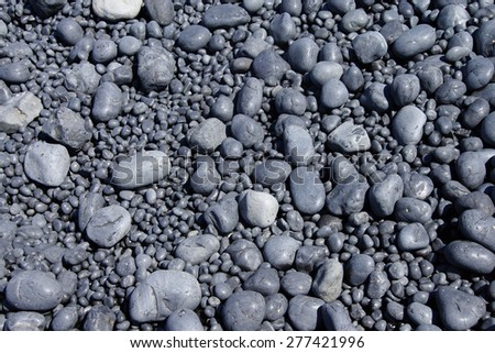 Cobbles, smooth and rounded, form patterns on the beach, Cobble Beach, Yaquina Head,  Oregon Coast - stock photo