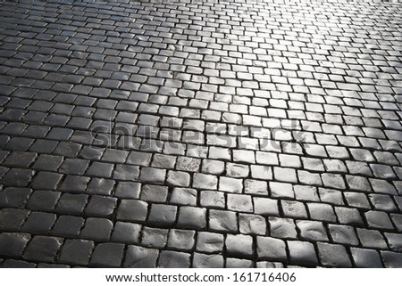 Cobblestone road, Italy - stock photo