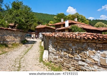 Cobblestone Street in Historic Zheravna, Bulgaria. - stock photo
