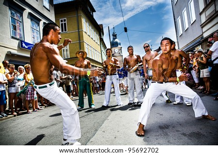 COBURG, GERMANY - JULY 11: Unidentified male capoeira dancers participate at the annual samba festival in Coburg, Germany on July 11, 2010. - stock photo