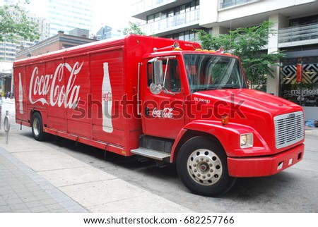 CocaCola Truck With Logos And Glass Bottle Image - Soft Drink / Pop - Vintage / Retro Red Vehicle - TORONTO, CANADA - July 2017