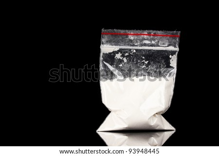 Cocaine in package on black background - stock photo