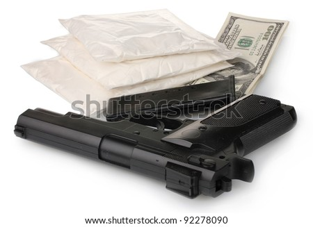 Cocaine in packet with gun and money isolated on white