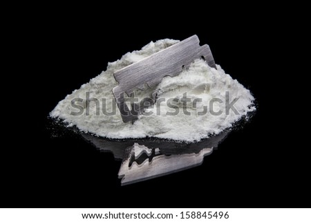 Cocaine with Razor Blade on black background - stock photo