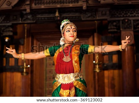COCHIN, INDIA - JANUARY 21: Indian girl dancing classical traditional Indian dance Bharat Natyam on January 21, 2016 in Kerala Kathakali Center in Fort Cochin, South India.