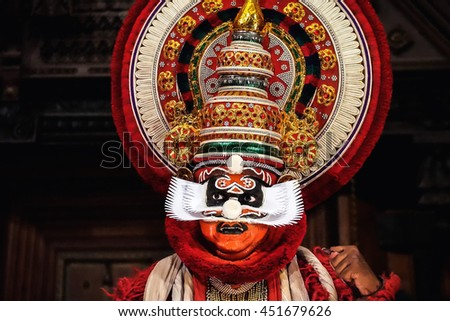 COCHIN, INDIA - NOVEMBER 23, 2015: Portrait of the unidentified kathakali performer wearing demon costume during the traditional kathakali dance of Kerala's state in India. - stock photo
