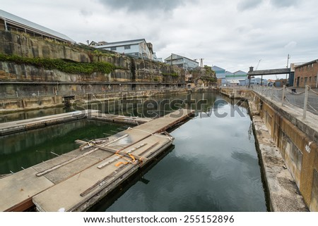COCKATOO ISLAND, SYDNEY, AUSTRALIA - DECEMBER 28, 2014: Disused ship yard on Cockatoo Island, once a busy dock and former prison, now a popular tourist attraction in Sydney. In December 2014. - stock photo