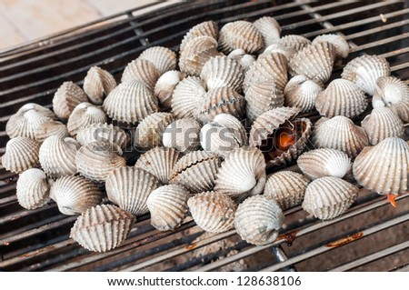 Cockles grill on sieve - stock photo